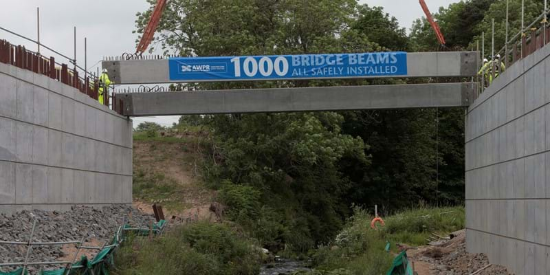 AWPR 1000th beam lifted into place